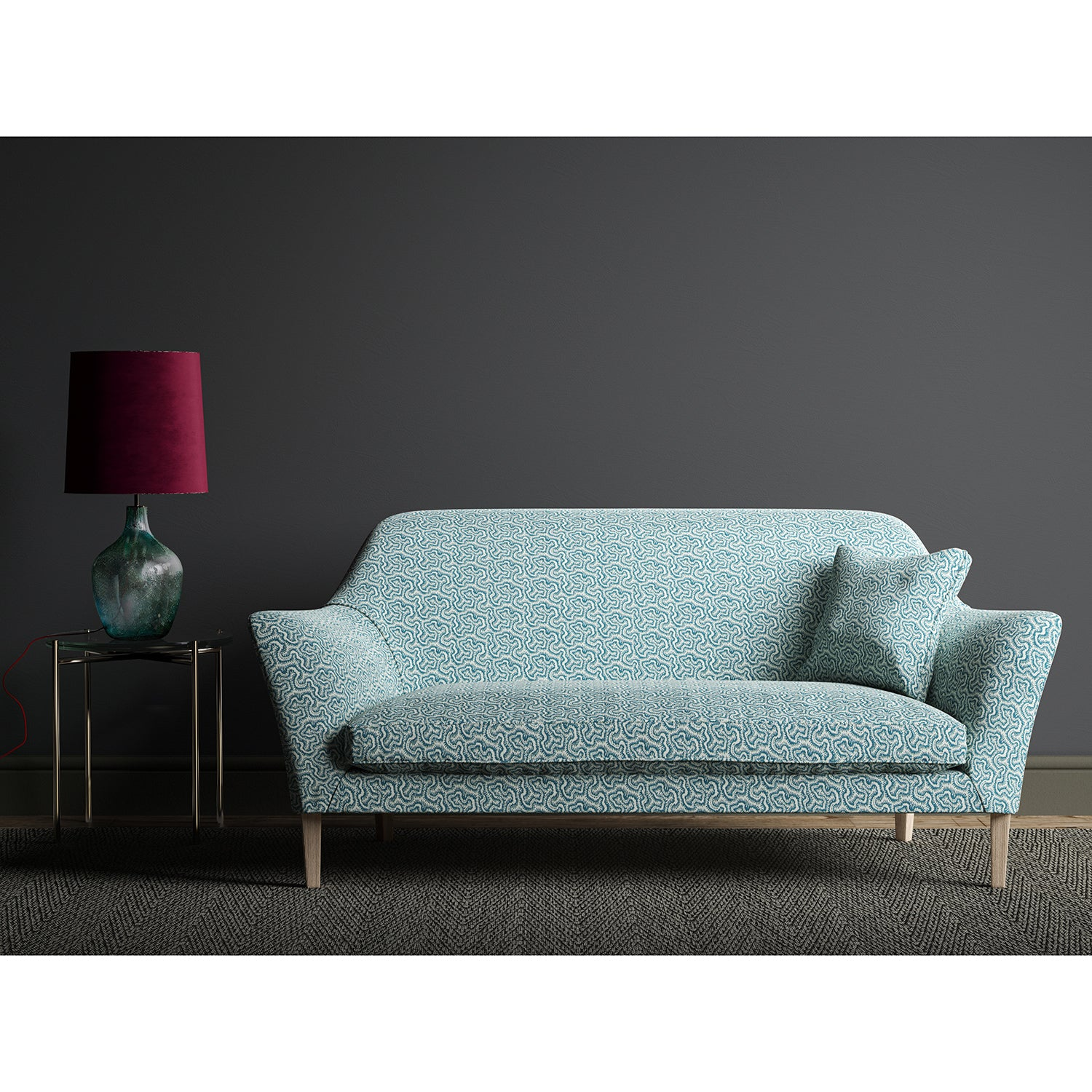 Sofa upholstered in a blue and white wavy weave fabric.