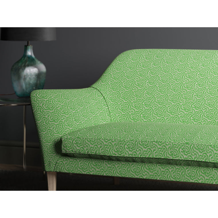Sofa upholstered in design name Polka, colourway Grasshopper from Tango Weaves.