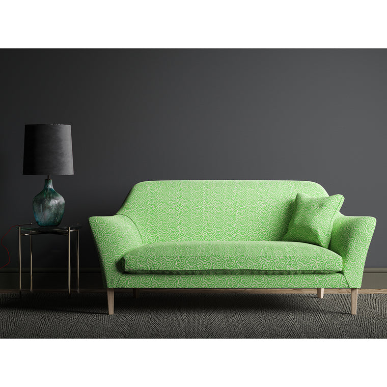 Sofa upholstered in a green and neutral wavy weave fabric.