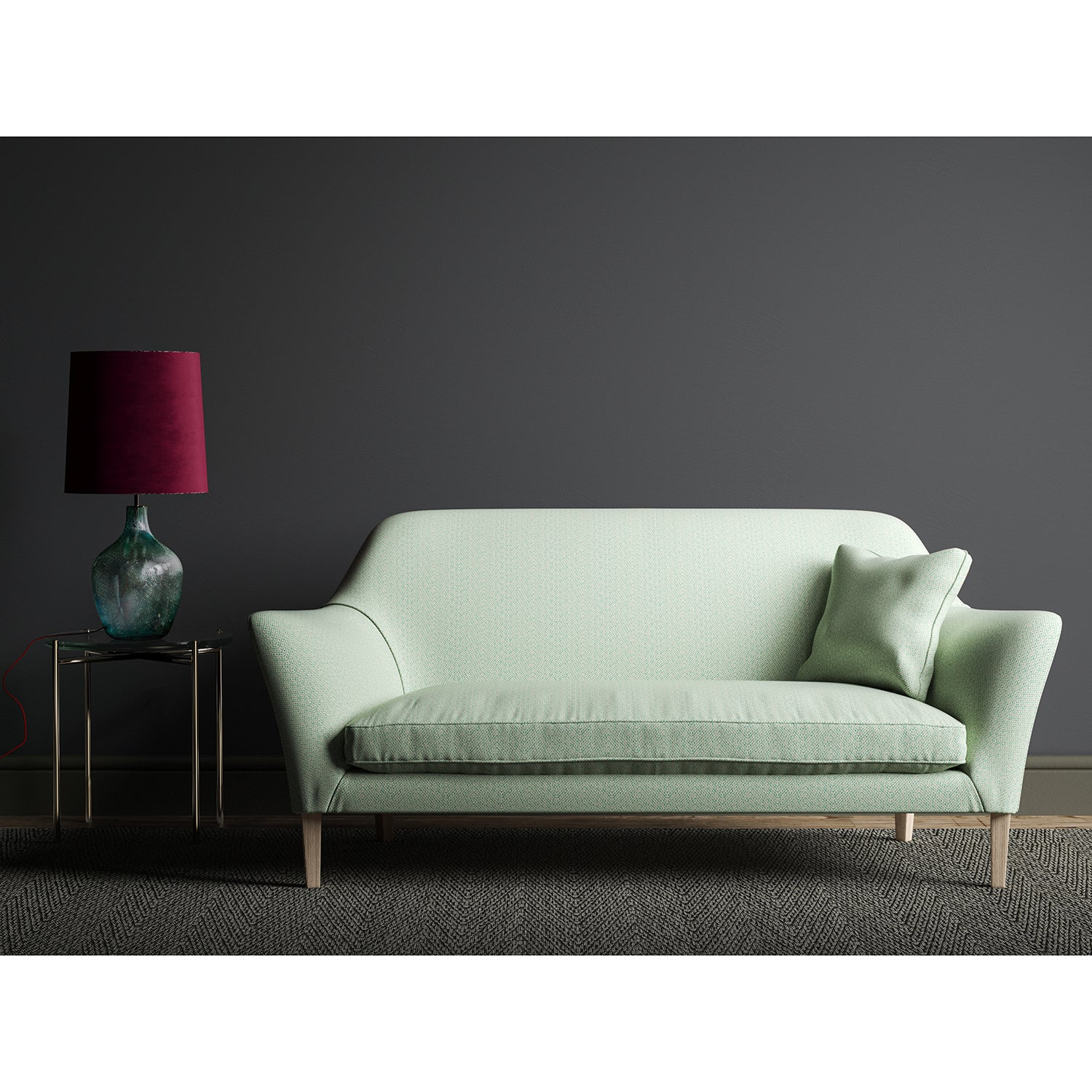 Sofa upholstered in a turquoise and white geometric weave fabric.