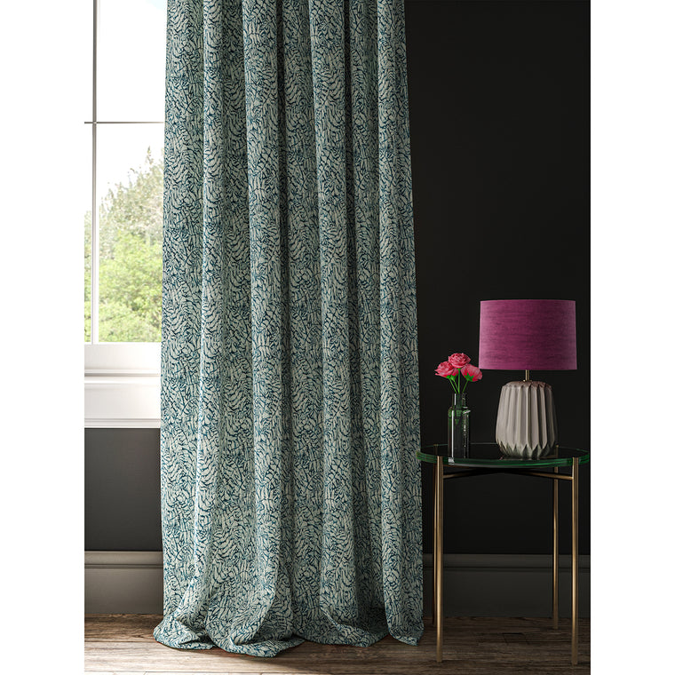 Dark blue curtain wiht a small white tropical print