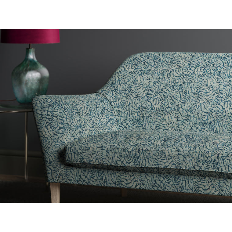Dark blue sofa with a small white print