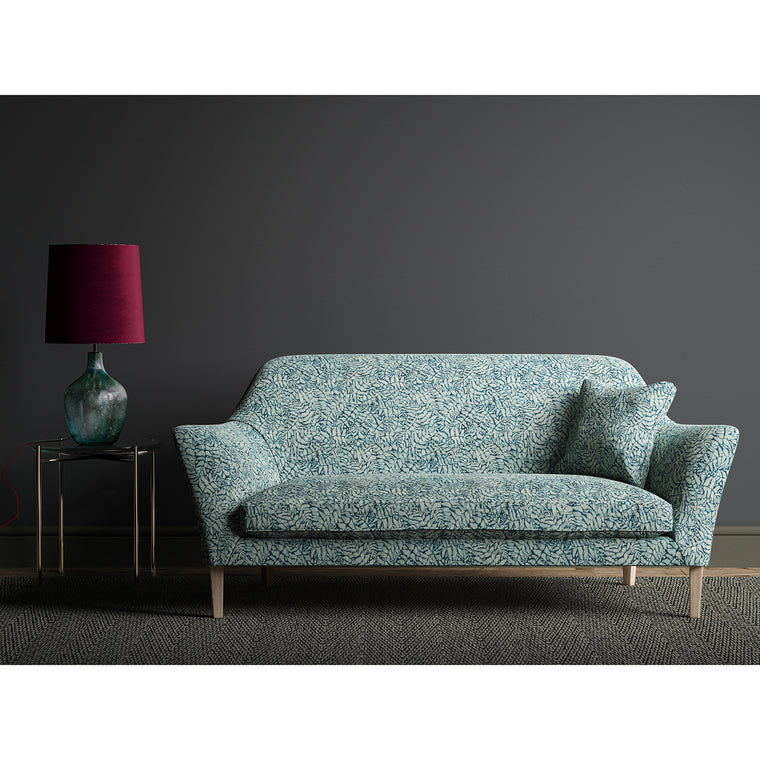 Sofa upholstered in a dark blue fabric with a small white print