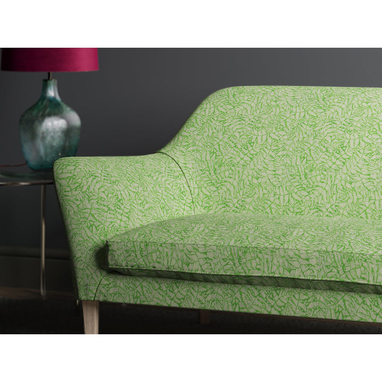 Sofa in a green fabric with a small white print