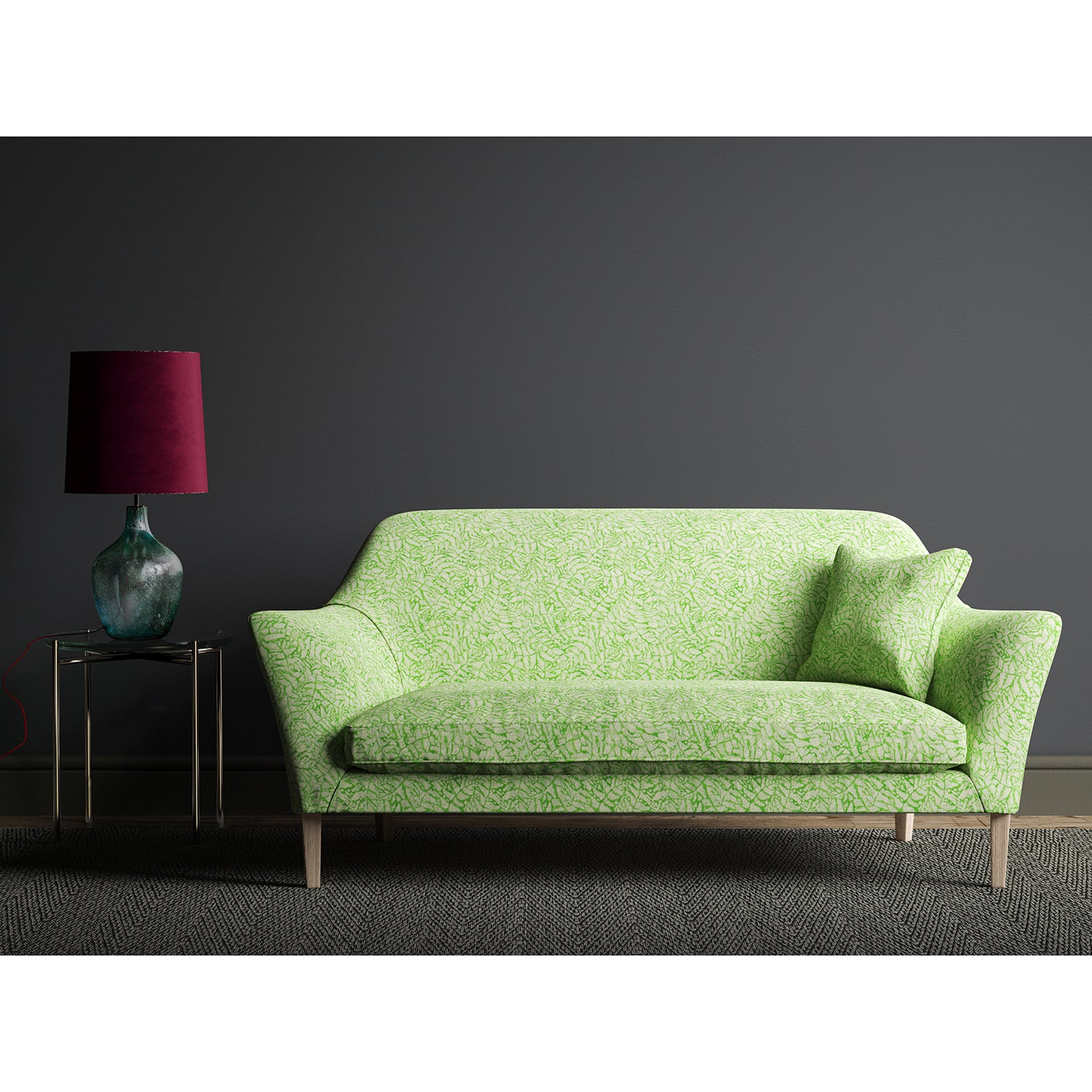 Sofa upholstered in a green fabric with a small white print