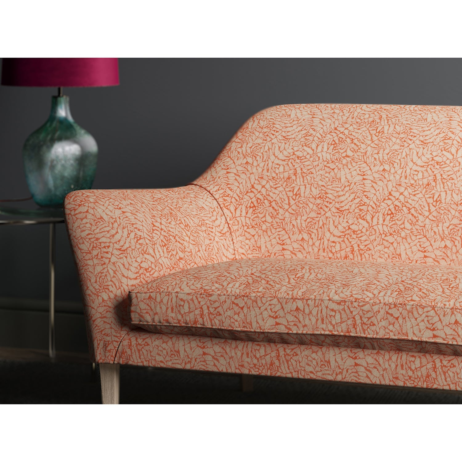 Sofa upholstered in a orange fabric with small white print
