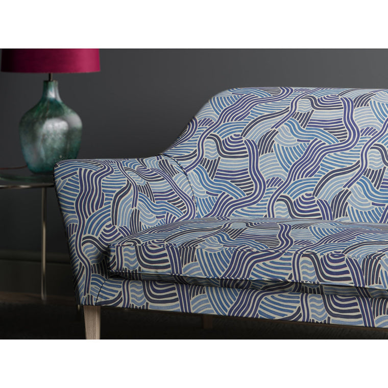 Sofa in a blue wavy upholstery fabric