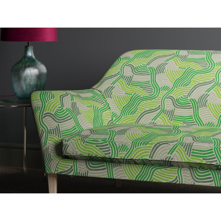 Sofa in a green wavy printed fabric