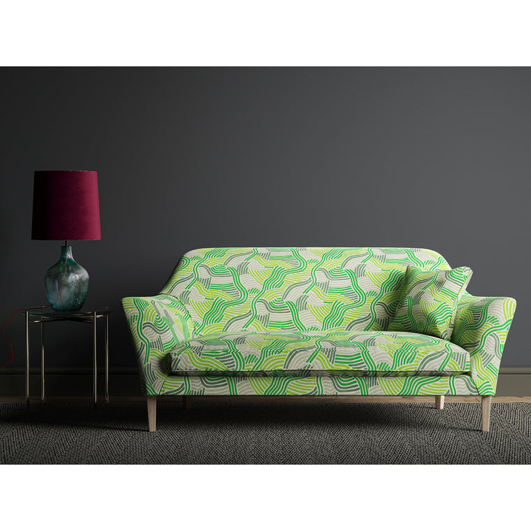 Green sofa with a printed modern wavy fabric