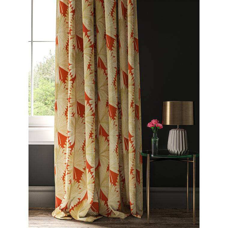 Orange curtain with a printed fan design