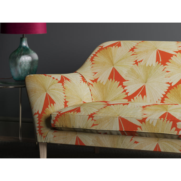 Orange sofa with a printed fan design