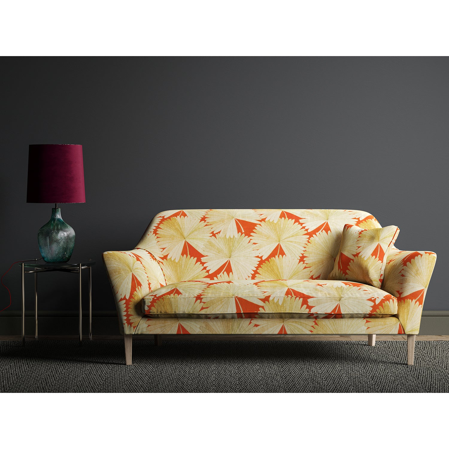 Sofa in a orange fabric with oriental printed fan design