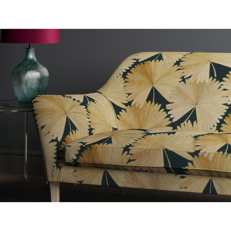 Sofa in a black fabric with printed fan design