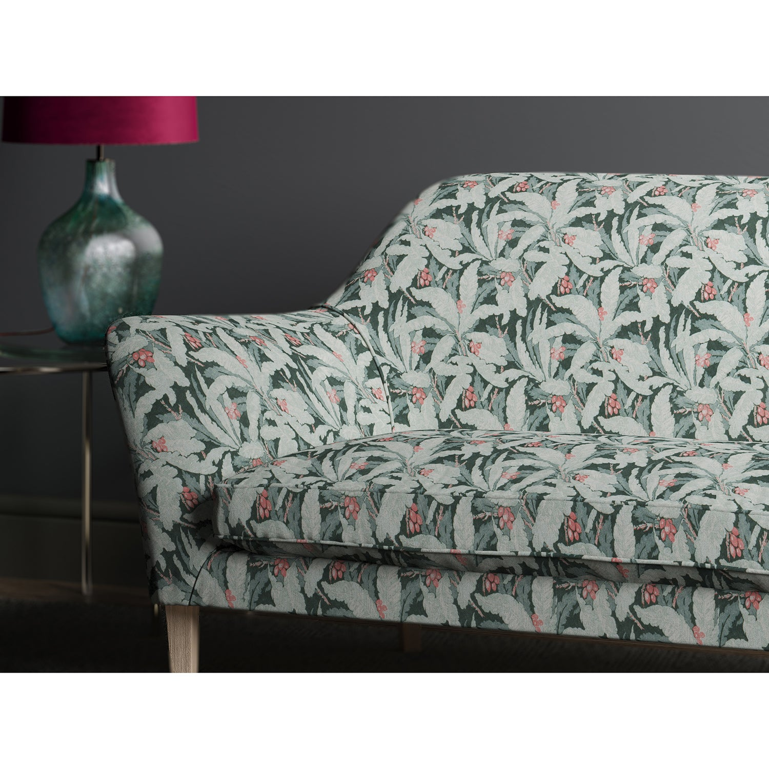 Sofa in a printed blue fabric with tropical leaf design