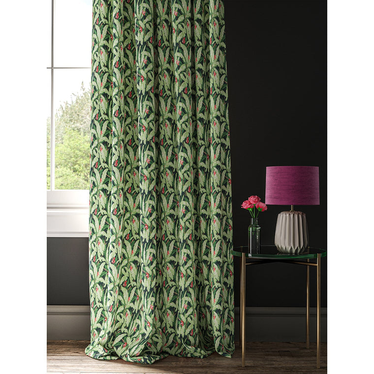 Curtain in a navy and green tropical leaf print fabric