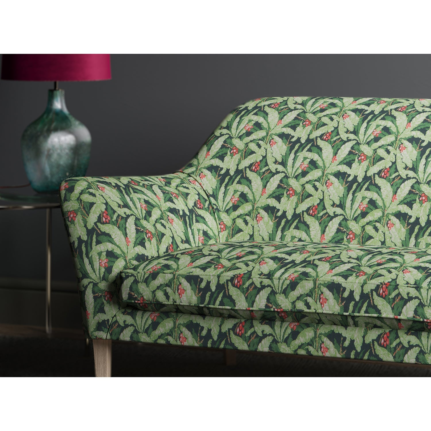 Sofa in a tropical navy and green printed leaf fabric