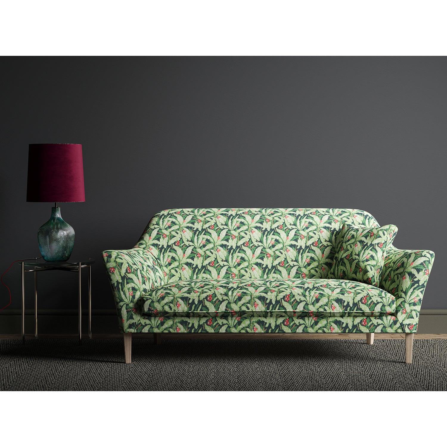 Navy and green sofa with a tropical leaf design