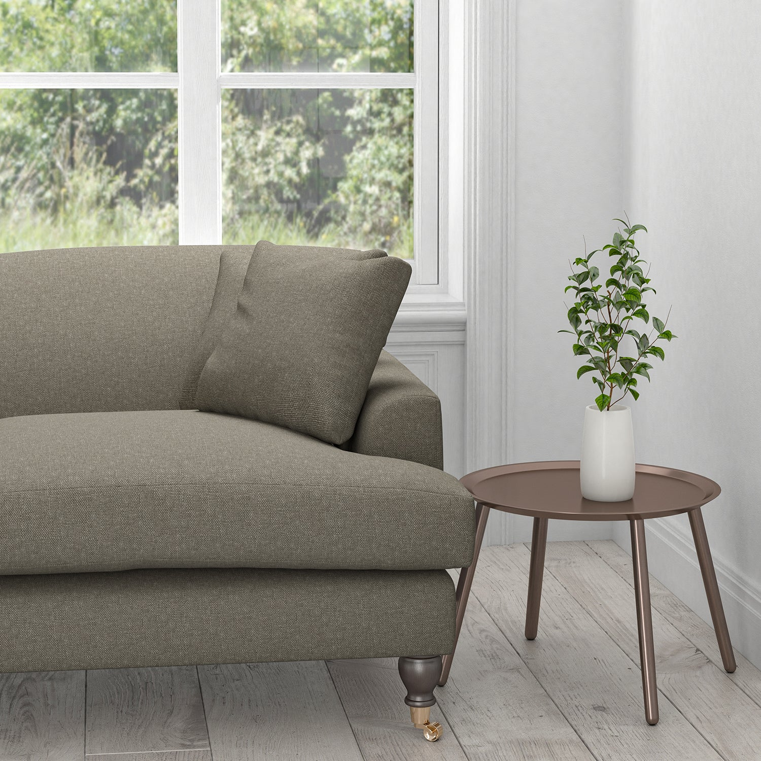 Sofa in a taupe coloured stain resistant fabric for curtains and upholstery