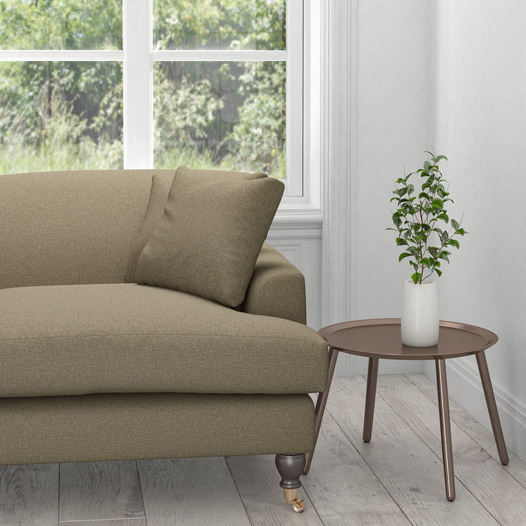 Sofa upholstered in a mid-brown plain cotton furnishing fabric