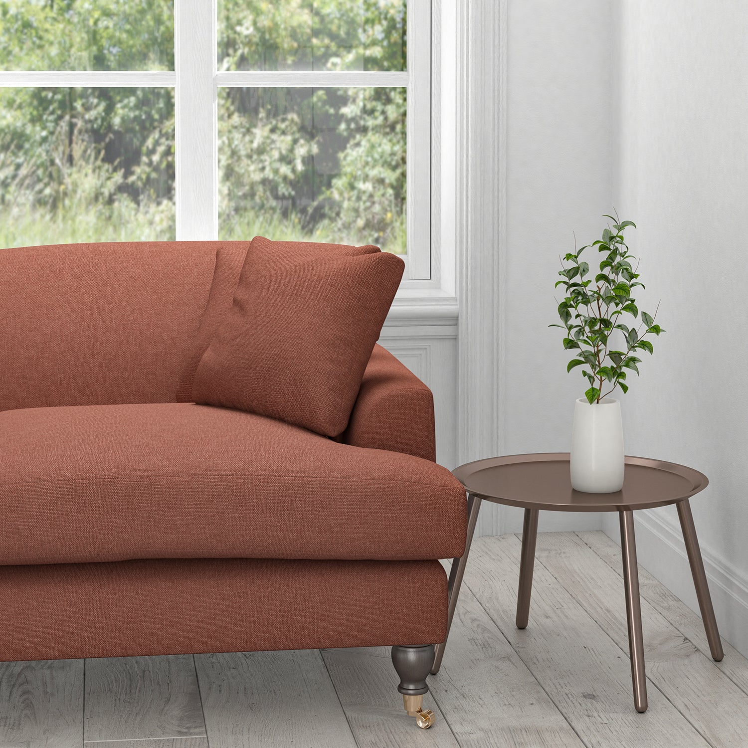 Sofa upholstered in a brick red plain washable furnishing fabric