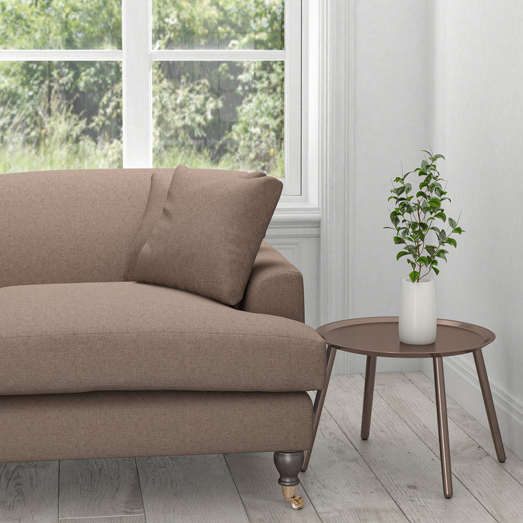 Sofa upholstered in a mauve cotton washable upholstery fabric