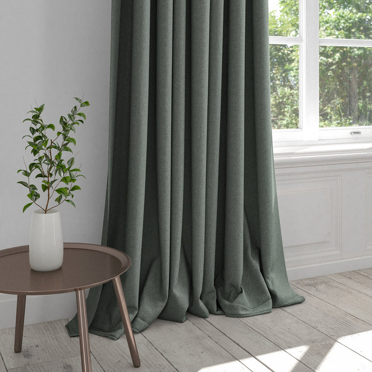 Curtain in a plain aqua cotton fabric with a stain resistant finish