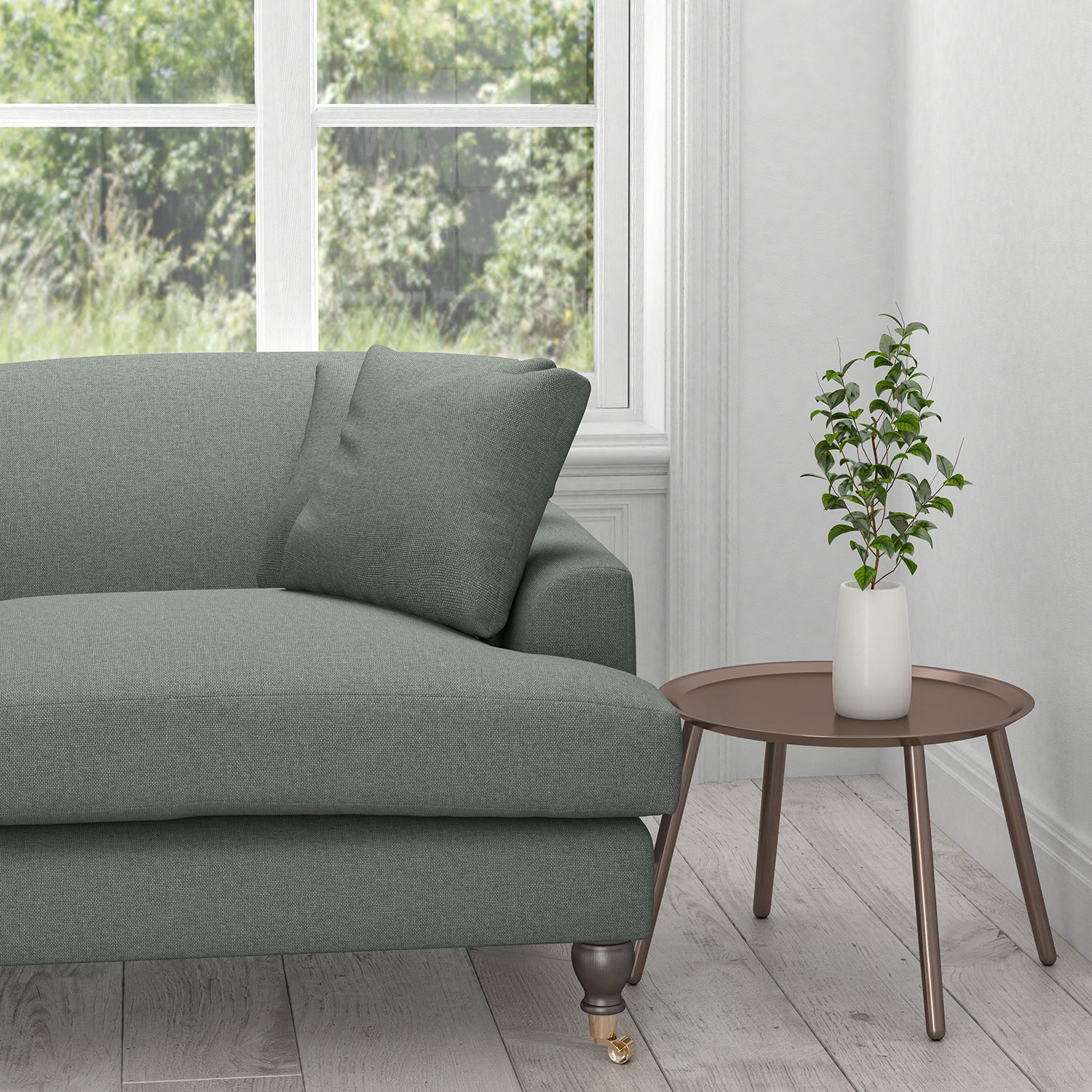 Sofa upholstered in a plain cotton washable aqua furnishing fabric