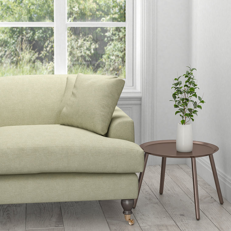 Sofa in a plain cream washable upholstery fabric
