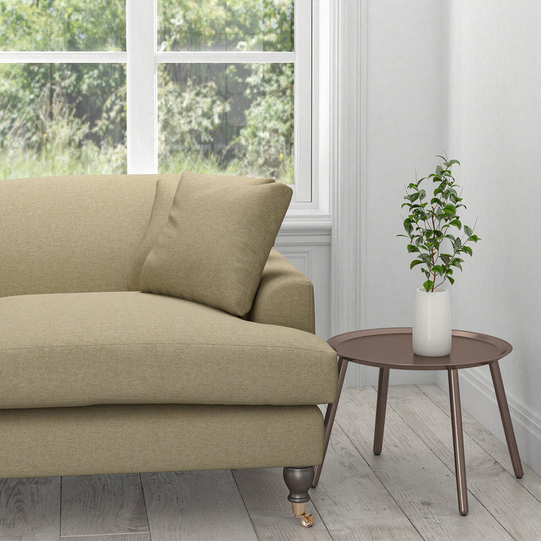 Sofa upholstered in a plain brown cotton furnishing fabric