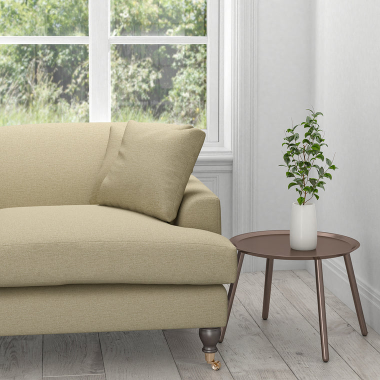 Sofa upholstered in a neutral plain cotton washable fabric