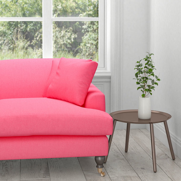 Sofa in a plain candy pink cotton fabric for contract and domestic upholstery