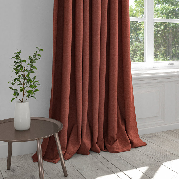 Curtain in a berry coloured plain cotton fabric