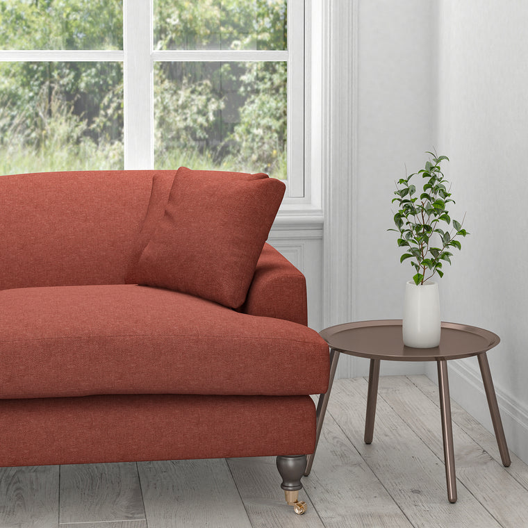 Sofa in a berry coloured plain cotton upholstery fabric