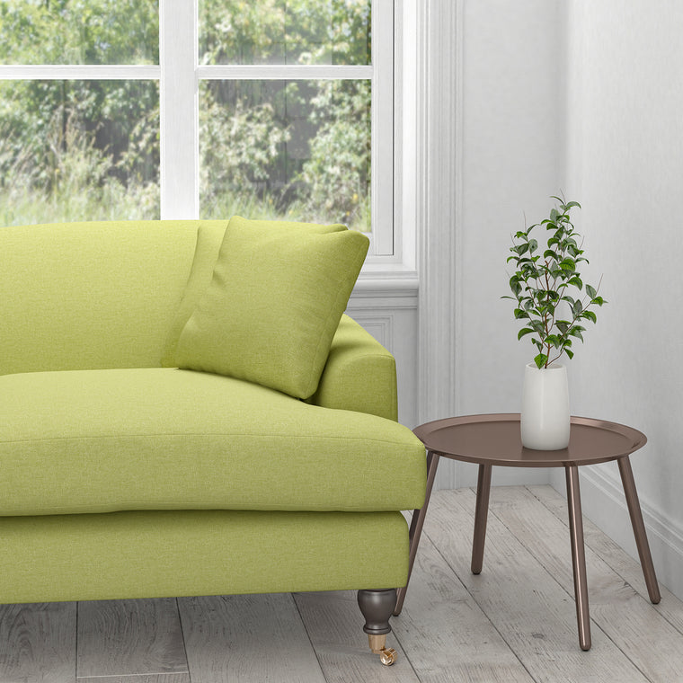 Sofa in a plain lime green cotton upholstery fabric