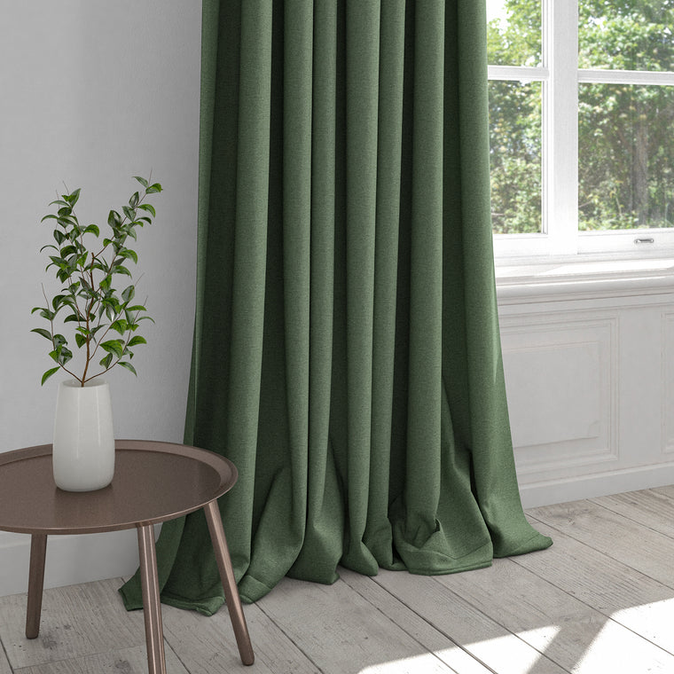 Curtain in a plain sage green cotton fabric