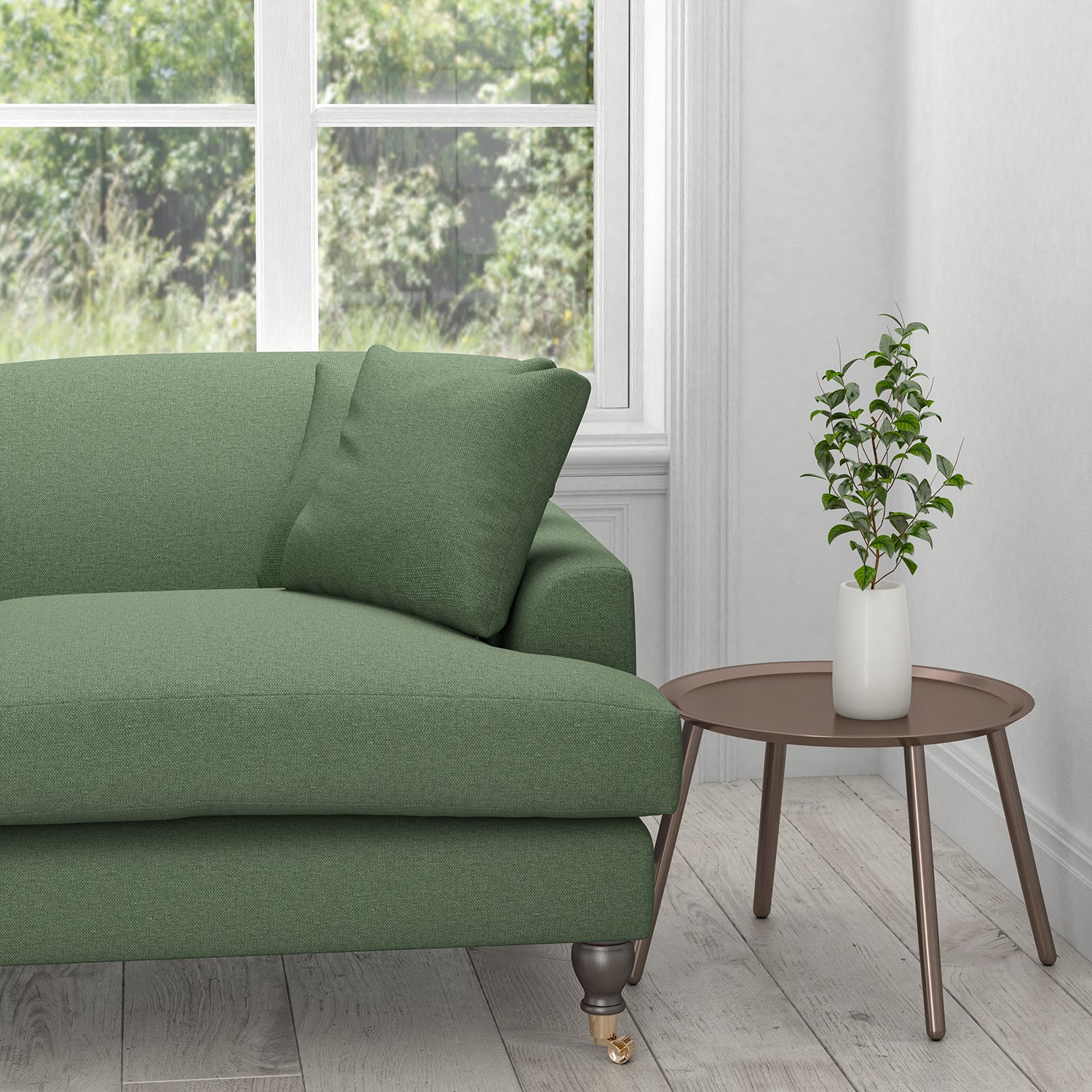 Sofa in a plain cotton sage green upholstery fabric