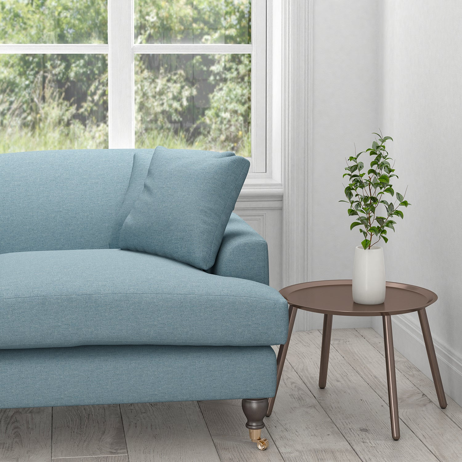 Sofa in a plain powder blue cotton upholstery fabric