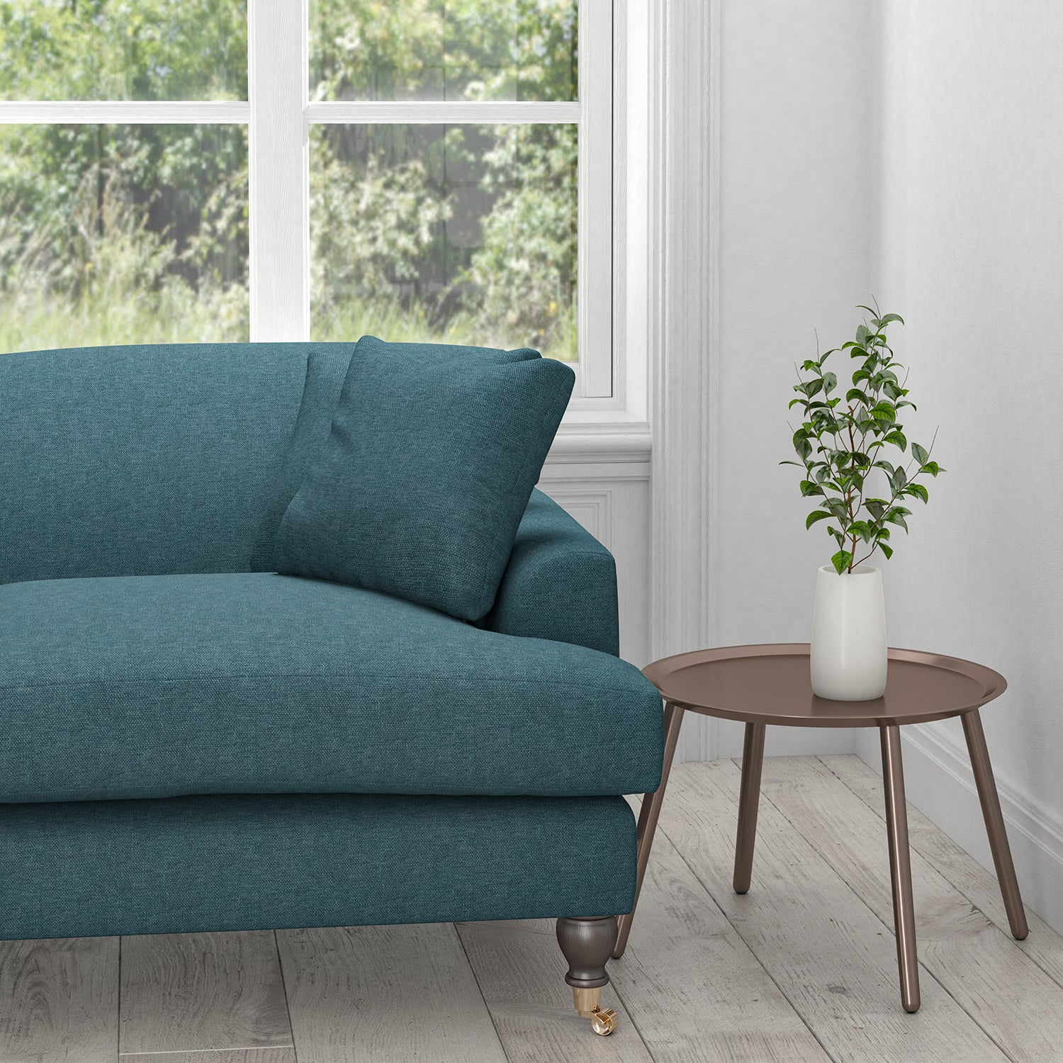 Sofa upholstered in a ocean blue plain cotton fabric