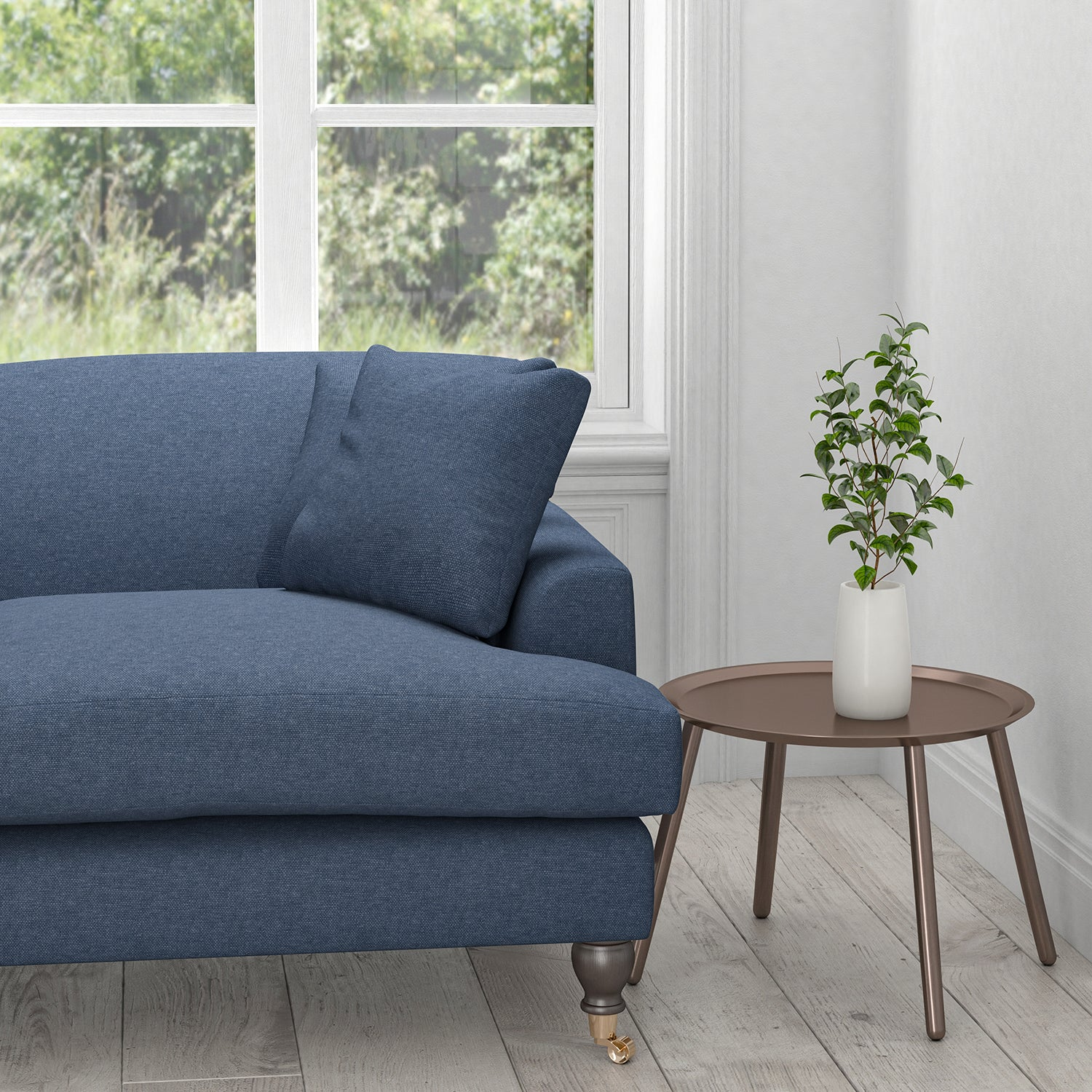 Sofa upholstered in a midnight blue plain cotton upholstery fabric