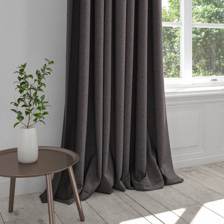Curtain in a plain dark petrol blue cotton fabric