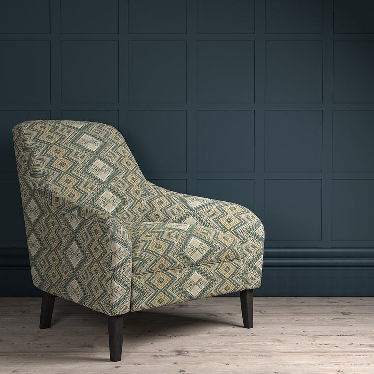 Chair upholstered in a grey coloured geometric upholstery fabric