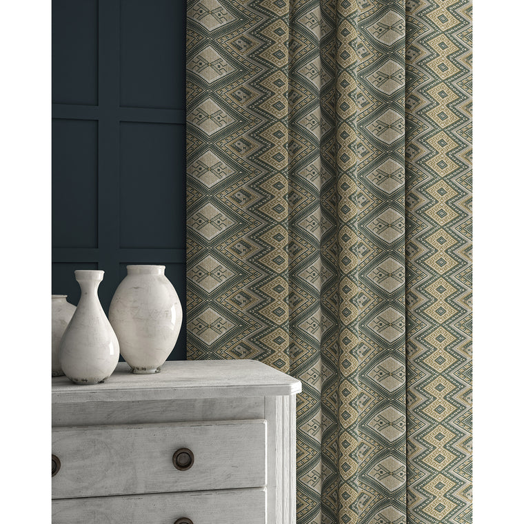 Curtains in a grey coloured geometric weave fabric