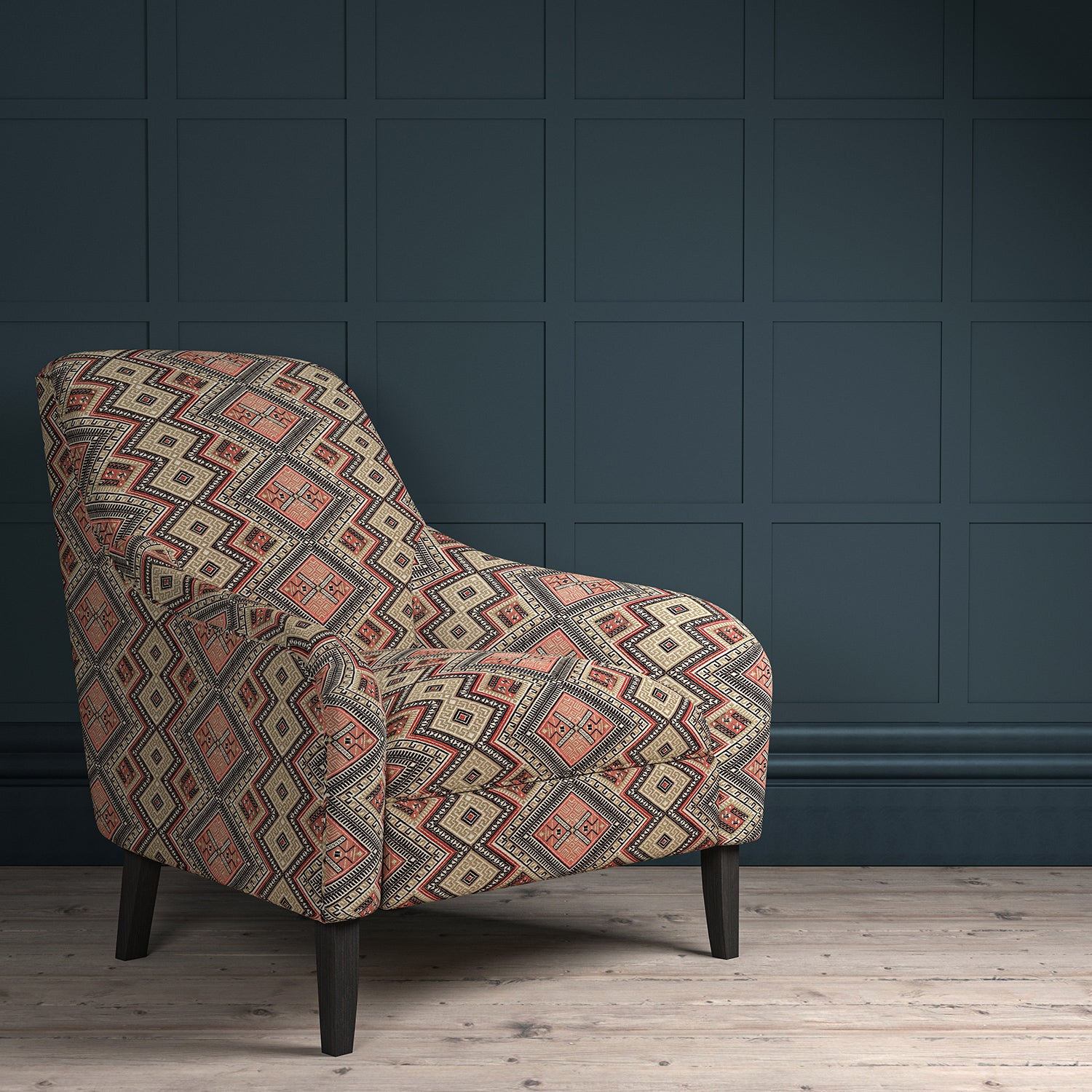 Chair upholstered in a coral coloured geometric upholstery fabric