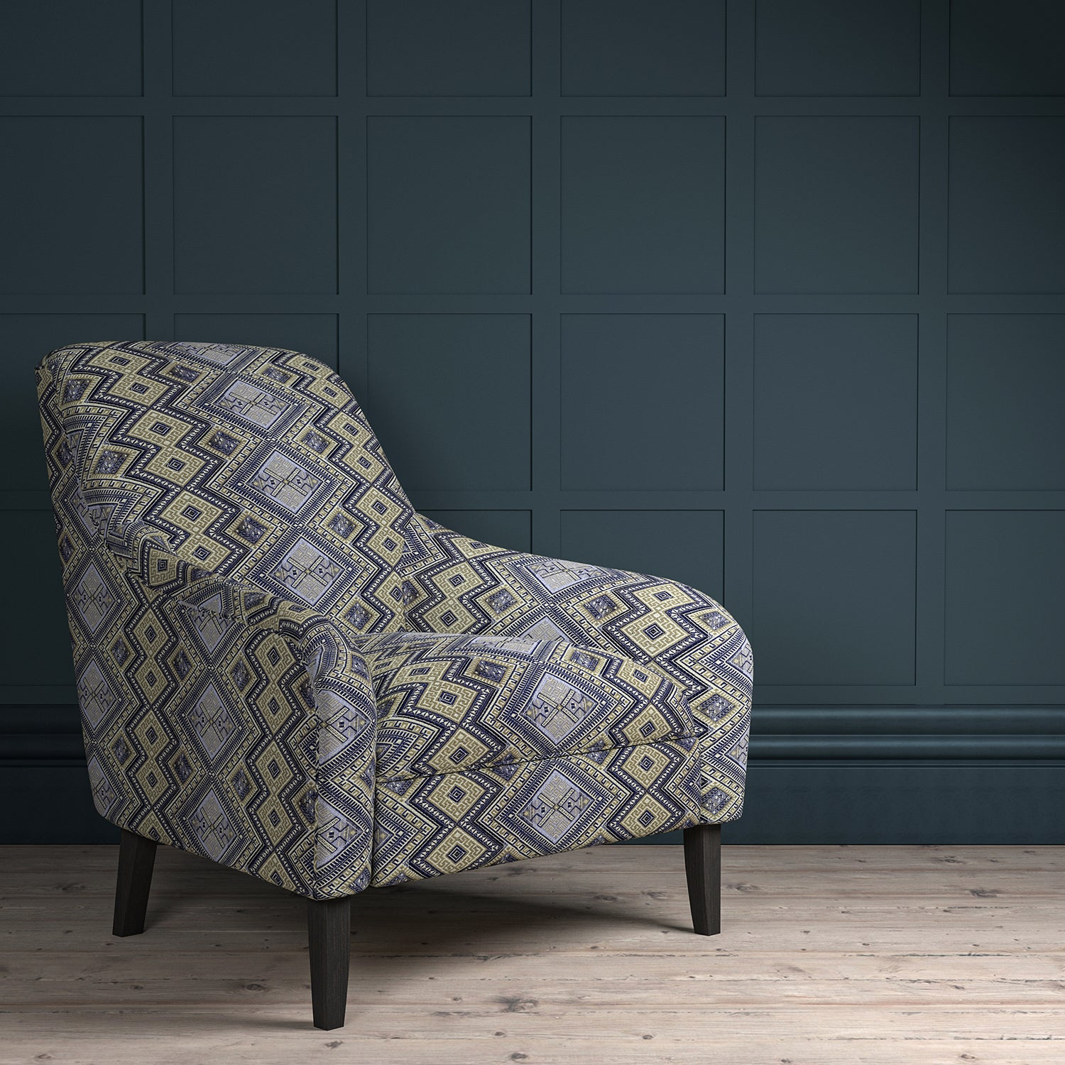 Chair upholstered in a blue coloured geometric upholstery fabric