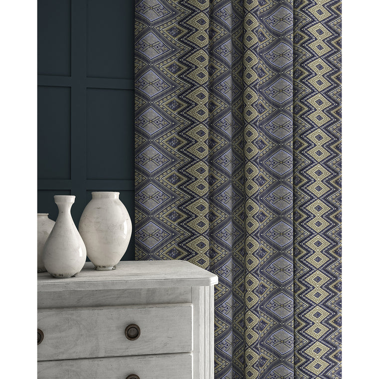Curtains in a blue coloured geometric weave fabric