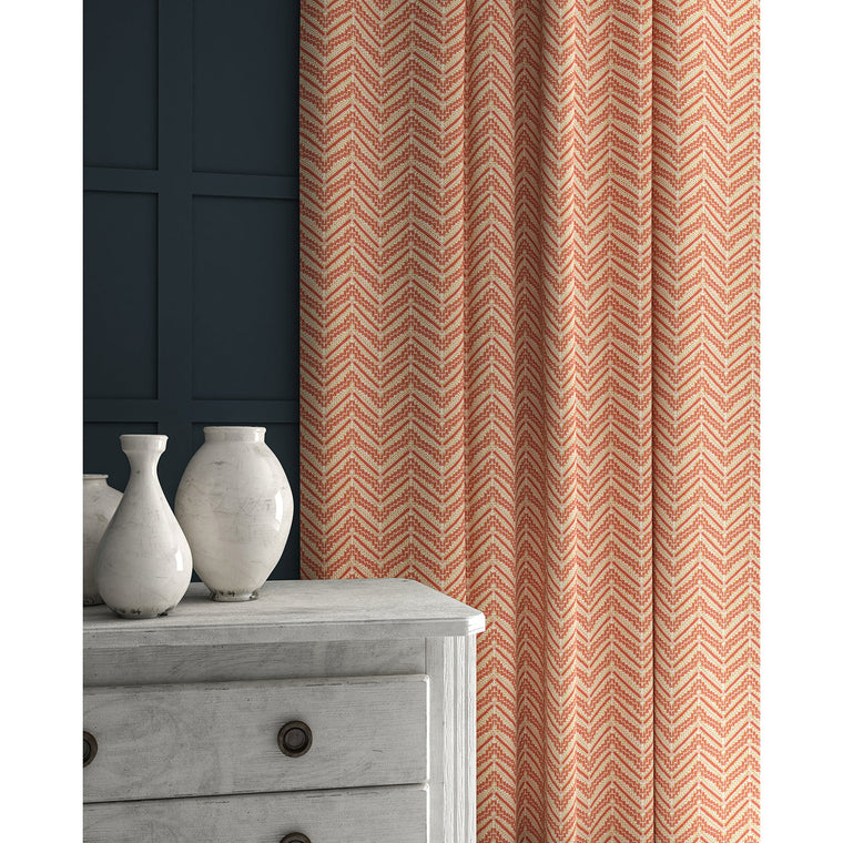Curtains in a peach coloured zig zag geometric weave fabric