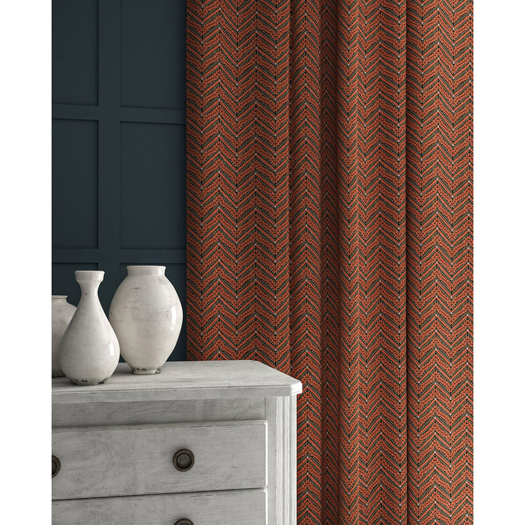 Curtains in a dark orange coloured zig zag geometric weave fabric