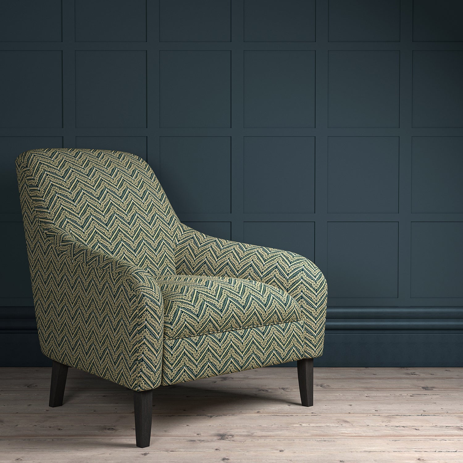 Chair upholstered in a dark grey coloured zig zag geometric upholstery fabric