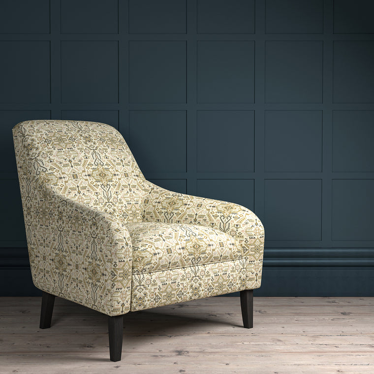 Chair upholstered in a light neutral coloured large scale geometric upholstery fabric