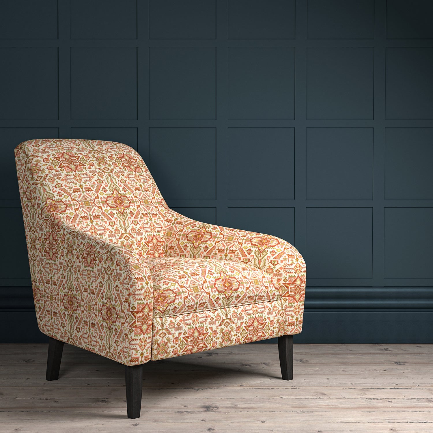 Chair upholstered in a orange and neutral coloured large scale geometric upholstery fabric